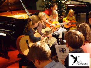 gitartimer Oslo barn gitarlærer gitarkurs gitarundervisning gitar timer gitar kurs musikkskole gitarskole Oslo Majorstua Bislett lær å spille gitar lære gitar gitarglede
